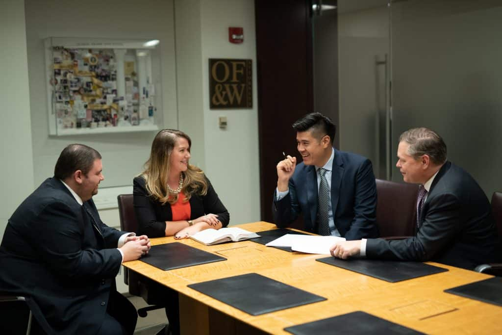 OFW law team sitting at a table