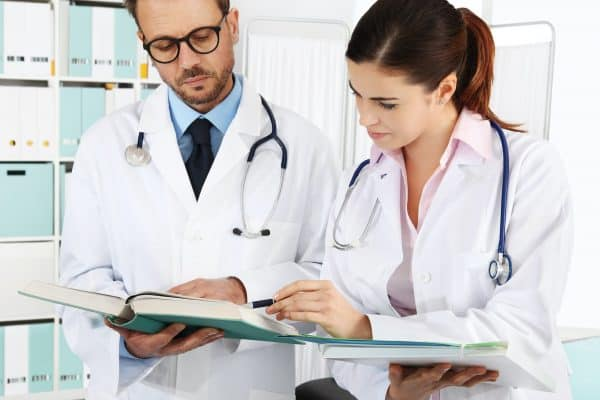 doctors reviewing medical documents