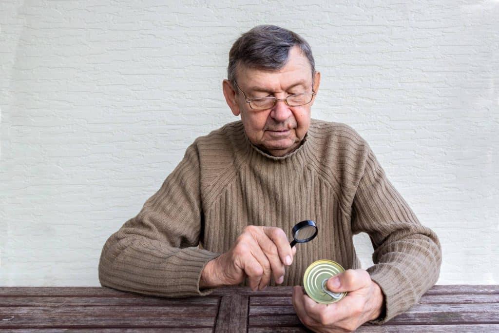 Elderly man reading food product label