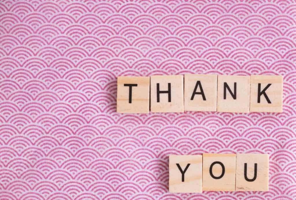 Scrabble letters on table saying thank you
