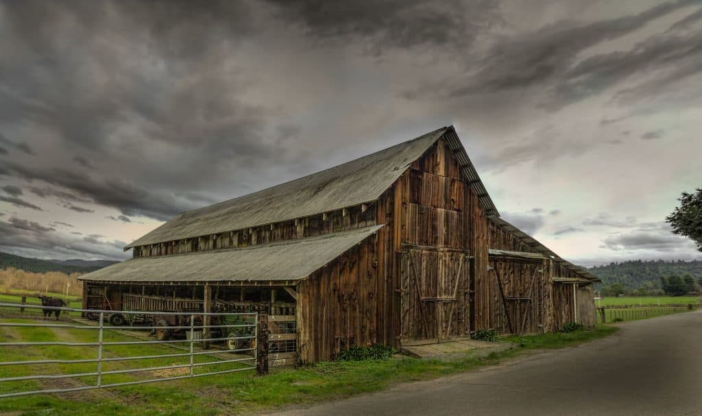 Farm with stormy clouds above