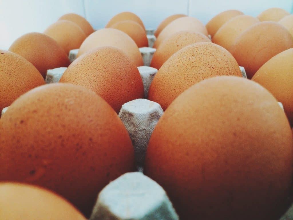 fresh eggs in a cardboard tray