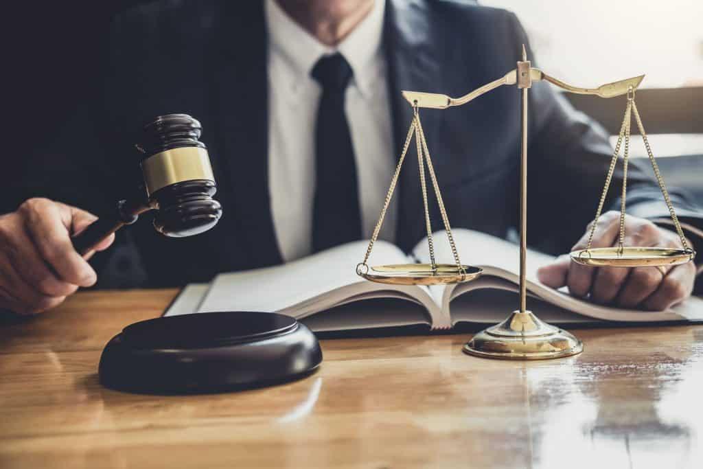 Judge hits gavel on table