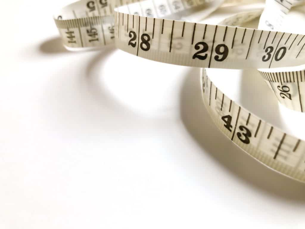 Measuring tape on white table