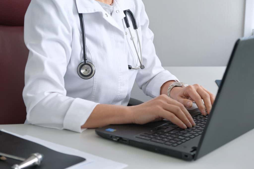 Health care professional working on computer